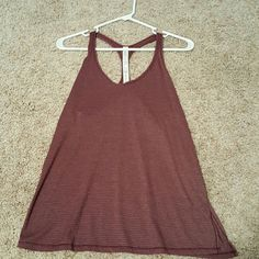 Lululemon Sweat it out Racer tank NWT NWT Sweat it out Racer tank Vent on the left side Size 6 lululemon athletica Tops Tank Tops