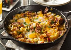 This awesome country breakfast skillet recipe is loaded with fresh potatoes, bacon, eggs, cheese and is super easy to make! Perfect for the weekend.