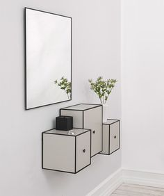 Frame storage units by by Lassen. Frame is an adaptable modular storage system consisting of a family of minimal boxes defined by a cubic frame. With or without doors and in a variety of sizes and finishes, they can be combined in numerous ways to meet your own particular storage needs. The Frame system was inspired by a sketch produced by Mogens Lassen in 1943, showing a storage solution based around square boxes with clearly defined frames. Frame units are available in seven different…