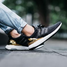 Adidas UltraBoost LTD. in black and gold