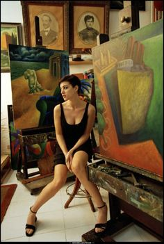 Monica Bellucci in painter Gaetano Tranchino's studio (1997). Photograph by Ferdinando Scianna. Fashion shoot. Bellucci, an Italian model and actress, made her American film debut in Bram Stoker's Dracula (1992). Her role in the French thriller The Apartment (1996), shot her to stardom as she won the French equivalent of an Oscar nomination.