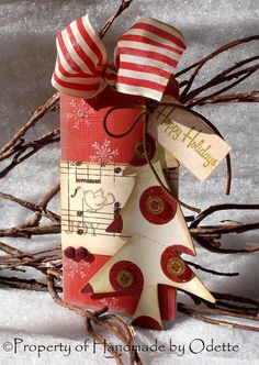 Love the strip of sheet music there with the little birdie stamped on it. - - - Christmas tag
