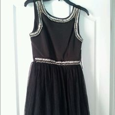 LBD - Party Dress. Never been worn. SZ 5 Little Black Party/Cocktail Dress; Beading at tank straps, waist and neck: Tulle overlay; Slightly pleated, Smoke free home. NEVER BEEN WORN!!! Love Reign Dresses