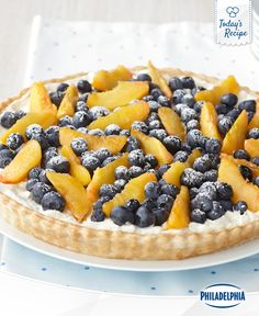 Start your summer with a refreshing blueberry and peach cream tart.