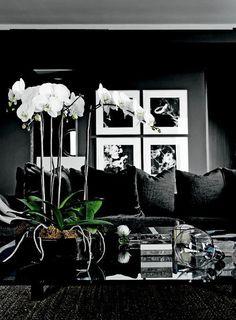 Wide white borders on framed art to beak dark walls.