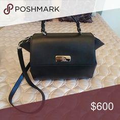 Giorgio Armani Purse Black calf leather purse with cotton blend lining. Used but in good condition. Armani Collezioni Bags Shoulder Bags