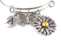 Perfect for a spring wedding!     Sunflower Butterfly Charm Bangle Flower Bracelet by SharlowAndCo