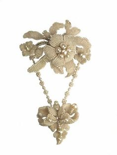 Seed pearl floral brooch, mounted on a gilt wire support with the pendant flower and leaf ornament suspended from two pearl strings   c. 1840