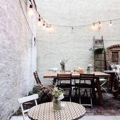 white washed brick and backyard patios