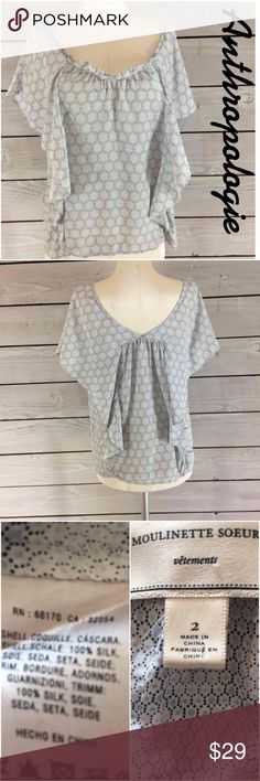 "Anthropologie Top with Flutter Sleeves Top. Anthropologie by Moulinette Soeurs Flutter Sleeves Top.  So Pretty. Between under arms 18"". Loose Fitting. Length 21 1/2"".  Soft print of mostly light blue.  Summer Perfect. Anthropologie Tops"