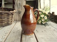 Vintage Wine Pitcher - French Classic Wine Jug - Brown Glazed Ceramic Carafe - 50 cl Jug - Rustic Stoneware - Made in France - French Table  ~~~~~~~~~~~~DIMENSIONS~~~~~~~~~~~~~  50 cl pitcher: Height: 6 3/4 in / 17 cm Diam. max: 3.5 in / 9 cm  430 g.  ~~~~~~~~~~~~CONDITIONS~~~~~~~~~~~~~  Good vintage condition - Only one pit on the inside of the pouring spout as you can see on pic. 3.  ~~~~~~~~~~~~INFORMATION~~~~~~~~~~~~  This item is shipped from France via priority non-trackable airmail…