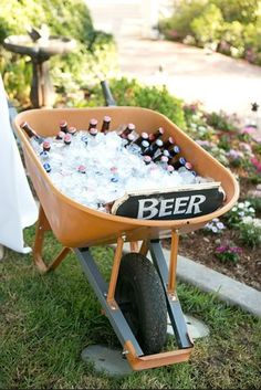 Barbeque / Garden Party Idea Great idea for all kinds of beverages! Obviously not beer...Glass Cokes from Costco, wheel barrow, Ice.... Also we used little red wagon....