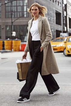 A single-breasted coat, such as Karlie Kloss's Smythe topper, is simplistic and sleek, and pairs perfectly with a white tee and modern trousers
