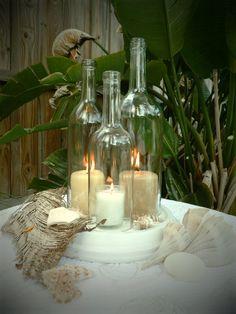 Wedding centerpiece White Triple Wine Bottle Candle Holder Hurricane Lamp. $49.95, via Etsy.
