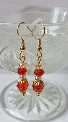 Red and Gold Crystal Earrings Elegant earrings with red crystals and gold plated elements