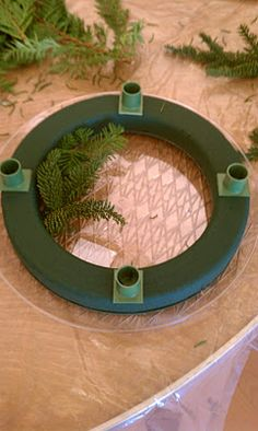 DIY Advent Wreath if I could find the candle holders...and then I would just wrap the entire wreath in burlap and add a few decorations.