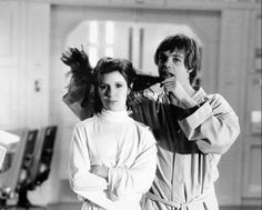 Carrie Fisher and Mark Hamill ham it up behind the scenes of 'Star Wars: Episode V: The Empire Strikes Back' (1980).