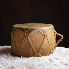 This two sided drum is hand-made from rawhide and wood. Powwow drums and hand drums have spanned many generations. It measures six inches long and eight inches thick. #Drum #nativeamericandrum #nativeamerican #twosideddrum #handmade #rawhide #powwow #handdrum #aktlakotamuseum #giftshop