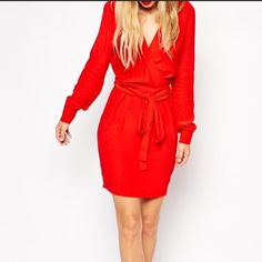 "Shop Women's ASOS Red size 6 Long Sleeve at a discounted price at Poshmark. Description: Bright red faux wrap Dress from ASOS Tall. Great for work or a night out. Hidden side zip closure. Measures approx. 40"" long from high point of shoulder to hem and 16"" across the waist when laying flat. 100% viscose.. Sold by danielledunc. Fast delivery, full service customer support."