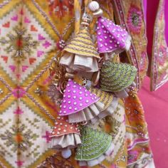Have you ever wondered of how a Latkan can uplift the look of your lehenga? A Latkan can transform a lehenga into a glamorous and gorgeous one! Saree Tassels Designs, Blouse Designs Silk, Stylish Blouse Design, Diy Tassel, Fabric Jewelry, Candy Colors, Textiles, Making Ideas, Embroidery Designs