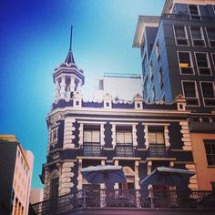 the awesome architecture of Long Street – Cape Town Tourism Cape Town Tourism, Cape Town South Africa, Diaries, Statue Of Liberty, Places To See, Spaces, Mansions, Architecture, Street