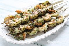 Grilled Pesto Shrimp Skewers |  1 cup fresh basil leaves, chopped 1 clove garlic 1/4 cup grated Parmigiano Reggiano 3 tbsp olive oil 1 1/2 lbs jumbo shrimp, peeled and deveined (weight after peeled) kosher salt and fresh pepper to taste 7 wooden skewers