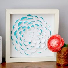 You won't believe how easy it is to create this 3D flower artwork. You could create multiple flowers with different colored paper!