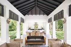 Contemporary White Poolside Cabana with contrasting dark painted wood louver door detail and paneled ceiling.