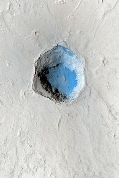 "Six sided, deep and oddly colored crater on Mars. Does this look ""natural"" to you? Yeah, me neither."