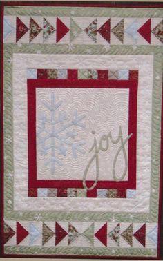 JOY on a winter quilt