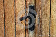 Photo about Old door - latch shaped cross. Image of rusty, wooden, iron - 94497525 Door Latch, Door Handles, Iron, Shapes, Doors, Stock Photos, Abstract, Pattern, Image