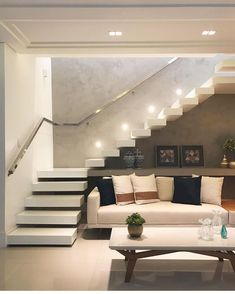 Loving this room with enjoyment of spaces under the stairs! Home Stairs Design, Interior Stairs, Home Room Design, Home Interior Design, Stair Design, Bungalow House Design, Small House Design, Modern House Design, Staircase In Living Room