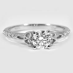 This diamond Celtic Love Knot ring features slender curves of precious metal that loop to form a graceful knot on each side of the center gem. This stunning ring is complemented by a delicate band of shared prong-set diamond accents. Celtic Wedding Rings, Wedding Rings Simple, Celtic Rings, Wedding Bands, Bling Bling, Celtic Love Knot, Celtic Knots, Square Diamond Rings, Love Knot Ring
