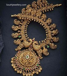 22 Carat gold deep nakshi work mango haram with peacock pendant studded with rubies, emeralds and diamonds by Navrathan Jewellers. Gold Temple Jewellery, Gold Wedding Jewelry, Bridal Jewelry Sets, Gold Jewelry, Gold Necklace, Bridal Jewellery, Collar Necklace, Antique Jewellery Designs, Antique Jewelry