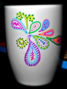Sharpie doodled coffee mug-  Use a permanent Sharpie and doodle whatever you'd like onto a ceramic cup, then bake the cup in the oven on 350 degrees for 30-45 minutes. Voila! You now have a beautiful gift!