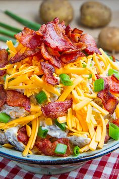 Loaded Baked Potato Salad 1 1/2 # potatoes, diced (optionally peeled) 1 c sour cream ,1/2 c cheddar shredded 4 strips bacon, cut into 1 inch pieces Fried & drained 4 green onions, sliced, salt and pepper  Boil the potatoes in water until just fork tender, about 15-20 minutes, drain and let cool completely. Mix everything and optionally, though highly recommended, let it chill in the fridge to allow the flavours to mingle before serving.
