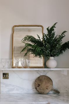 Decorate for the holiday season with artificial pine stems and greenery that looks real. Simply trim stems and plop in your favorite ceramic vase. Shop this look at Afloral.com.