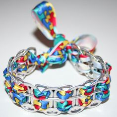 Pop Can Tab Bracelet... I've done these with string, but I like the ribbon!