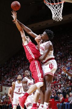 OG Anunoby Photos - Ethan Happ of the Wisconsin Badgers goes to the basket against OG Anunoby of the Indiana Hoosiers in the second half of the game at Assembly Hall on January 2017 in Bloomington, Indiana. Wisconsin defeated Indiana - Wisconsin v Indiana College Basketball, Basketball Court, Power Forward, Bloomington Indiana, Wisconsin Badgers, Indiana University, Two By Two, January, Poses