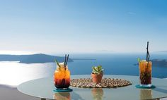 Luxury Suites Santorini combines a world of beauty and tradition! Imerovigli Santorini, Luxury Living, Cocktail, Candles, Traditional, Drink, Food, Luxury Life, Beverage
