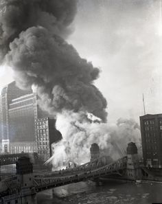 Fireboats fighting a burning building at LaSalle St, 1951, Chicago.