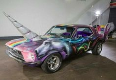 """THE UNISTANG: 1968 Ford Mustang Unicorn Pride Parade Car. Complete with removable bejazzled """"unihorn"""" (TM), magnetic """"go faster"""" wings , custom sparkle rainbow unicorn paint job and fluffy purple seat covers. Unicorn Car, Real Unicorn, Magical Unicorn, Rainbow Unicorn, Unicorn Birthday, Unicorn Pics, Unicorn Poster, Baby Unicorn, Lorie"""