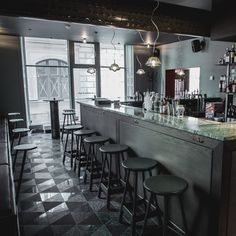 Divided into two bars, The Flying Elk boasts an upmarket, modern look with burnt oak panels set against marble, and polished copper against a verdigris furniture set, which is all a welcome departure from my pub experiences...