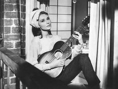 "audrey hepburn singing ""moon river""."