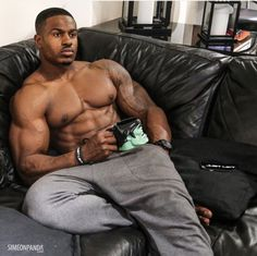 Simeon Panda on the couch at home..looking sexy!!