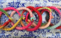 felted yarn bracelets with copper, precious stones, pearls, all straps are different.