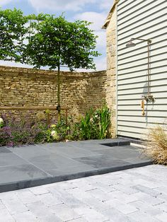 Nero Riven slate and Cameron Stone tumbled outdoor cobbles and flagstones | From Mandarin Stone.