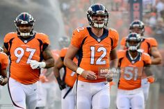 Quarterback Paxton Lynch #12 of the Denver Broncos runs out of the tunnel before taking on the Carolina Panthers at Sports Authority Field at Mile High on September 8, 2016 in Denver, Colorado.