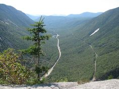 White Mountains, NH - The view from Mount Willard's ledges showing the U-shape of Crawford Notch.  That's Route 302 running through the center and the railroad tracks are to the right of the road. (photo by Karl Searl)