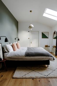 Light pours in onto two-tone Farrow & Ball-painted walls in the master bedroom. design master romantic accent walls The characterful East London townhouse of Melissa Hemsley and her art curator boyfriend Light Green Bedrooms, Bedroom Green, Small Room Bedroom, Master Bedroom Design, Small Rooms, Home Bedroom, Modern Bedroom, Bedroom Decor, Bedroom Ideas